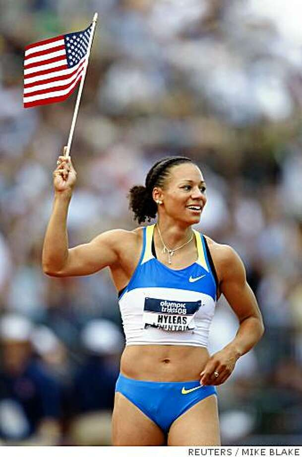 Hyleas Fountain, winner of the women's heptathlon event, runs a victory lap with a flag at the end of competition at the U.S. Olympic Track and Field Trials in Eugene, Oregon, June 28, 2008.  Johnson finished second overall in the heptathlon.   REUTERS/Mike Blake      (UNITED STATES)  (BEIJING OLYMPICS 2008 PREVIEW) Photo: MIKE BLAKE, REUTERS