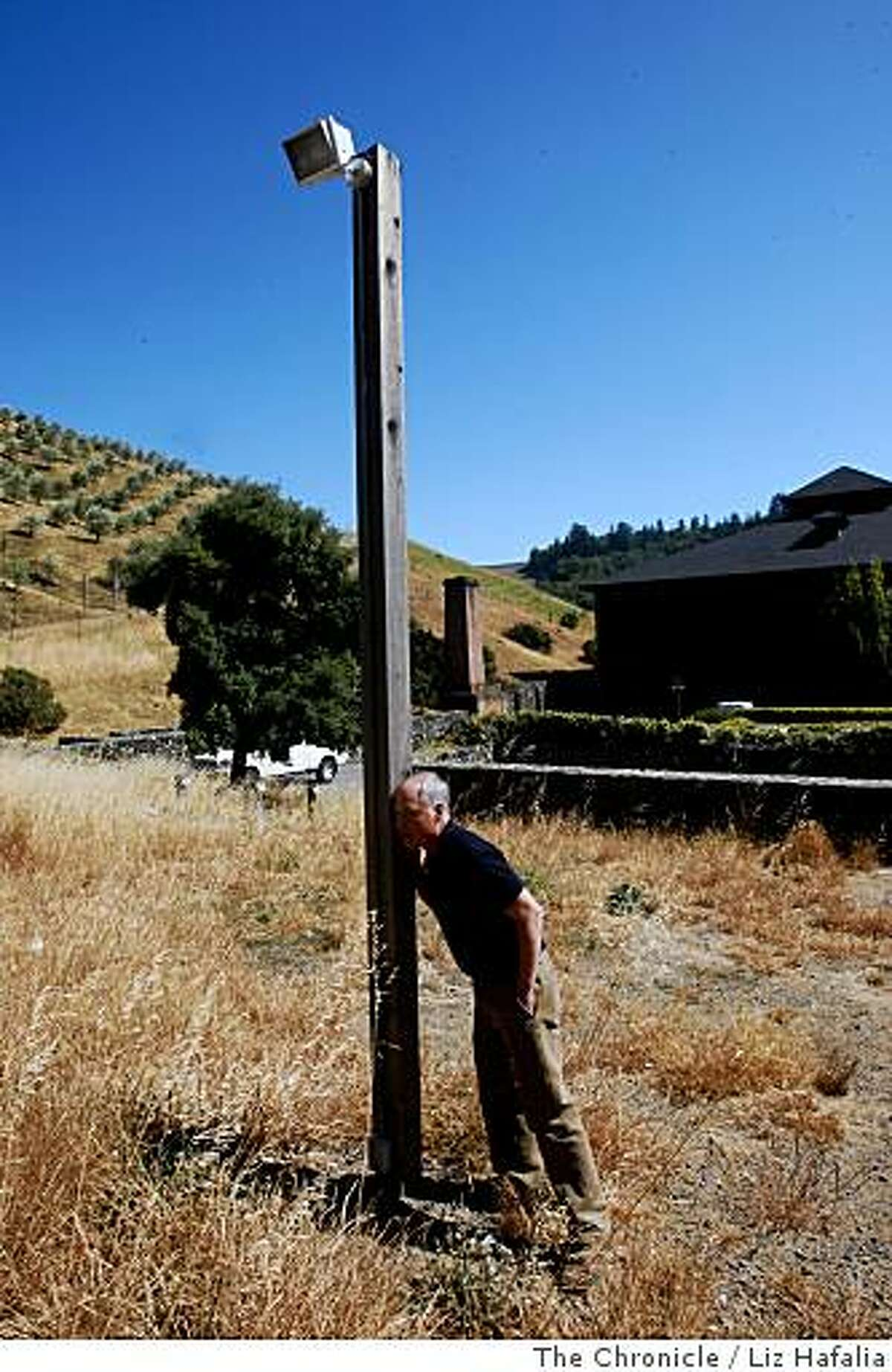 Sound designer Ben Burtt listens to find out if he can hear the buzzing from a parking lot lamp post he recorded at Skywalker Ranch in Marin on June 16, 2008. He used the sound for the skull characters in the new