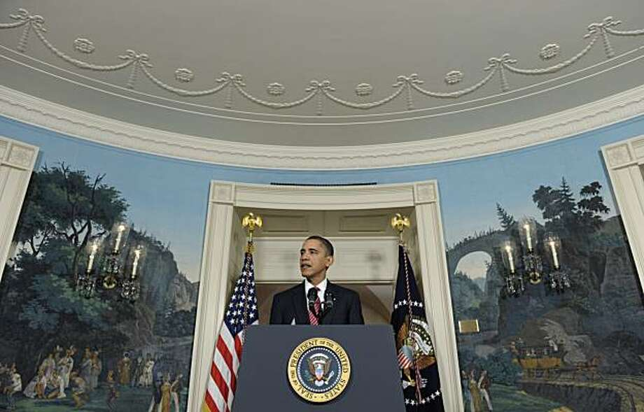 President Barack Obama makes a statement on the economy, Monday, Dec. 14, 2009, in the Diplomatic Reception Room of the White House in Washington, after his meeting with financial services executives. (AP Photo/Susan Walsh) Photo: Susan Walsh, AP