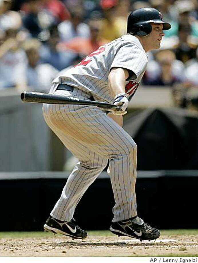 Minnesota Twins' Brian Buscher slaps a one-handed bloop single to right to drive in a run against the San Diego Padres in the sixth inning of a baseball game Thursday, June 26, 2008, in San Diego. (AP Photo/Lenny Ignelzi) Photo: Lenny Ignelzi, AP