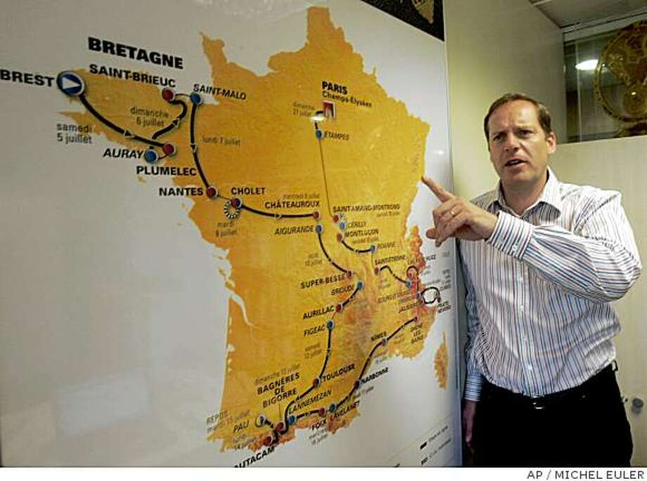 ** ADVANCE FOR WEEKEND EDITIONS, JUNE 28-29 **  Tour de France director Christian Prudhomme points to this year's race map in Paris, Thursday June 26, 2008. For the second straight year, the Tour de France starts without a defending champion. For that matter, cycling's premier race doesn't have the help of the sport's governing body because of a long-running feud that erupted this spring.  (AP Photo/Michel Euler) Photo: MICHEL EULER, AP