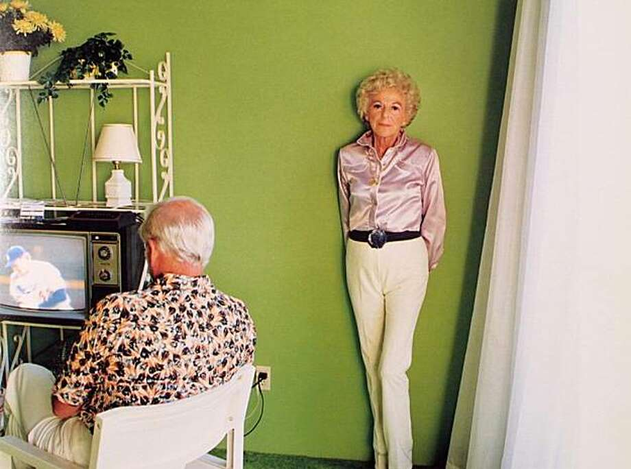 """ONE TIME USE ONLY!!!    """"Mom Posing by Green Wall and Dad Watching TV,"""" 1984, photograph by Larry Sultan. credit:  Courtesy Janet Borden Inc. Photo: Courtesy Janet Borden"""