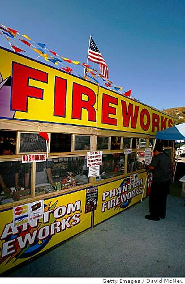 FILLMORE, CA - JUNE 30:  Customers buy fireworks for upcoming July 4th celebrations from the Grange fireworks stand on June 30, 2008 in Fillmore, California. Only schools, churches, and other non-profit organizations are allowed to sell fireworks in Fillmore. For some, it is their primary fund-raising event of the year. Last week, President Bush declared a state of emergency for all of California as 1,420 wildfires continue to burn across 550 square miles of central and northern California since being ignited by dry lighting strikes 10 days ago. Because of the high fire danger, Gov. Arnold Schwarzenegger has asked residents to not buy fireworks. Prolonged drought and years of fire suppression are cited by fire officials who predict more dangerous fires this year and a possible repeat of the massive firestorms of 2003 and 2007 that destroyed thousands of homes.    (Photo by David McNew/Getty Images) Photo: Getty Images