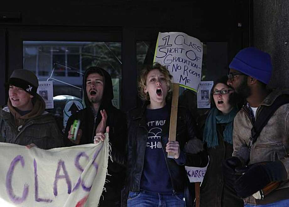 "Ivy Anderson (center) joins other San Francisco State Students, all upset by budgets cuts to their school, protest who protest outside the SFSU business department on Wednesday Dec. 9, 2009 in San Francisco, Calif. The protesters blocked all entrances to the school and a few protesters have holed themselves off inside. ""This is our time to unite,"" said Anderson. Photo: Mike Kepka, The Chronicle"