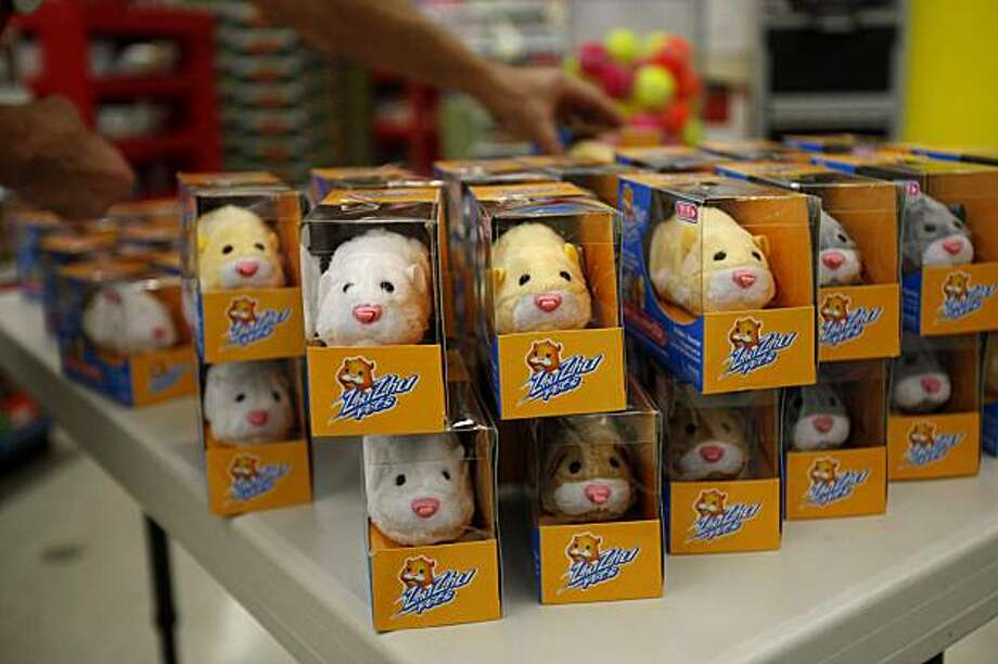 "Toys ""R"" Us employee Ray Singer stacks 100 Zhu Zhu Pets on a table before Black Friday holiday shopper are allowed inside Toys ""R"" Us in Camp Hill, Pa., late Thursday, Nov. 26, 2009.  (AP Photo/Carolyn Kaster) Photo: Carolyn Kaster, AP"