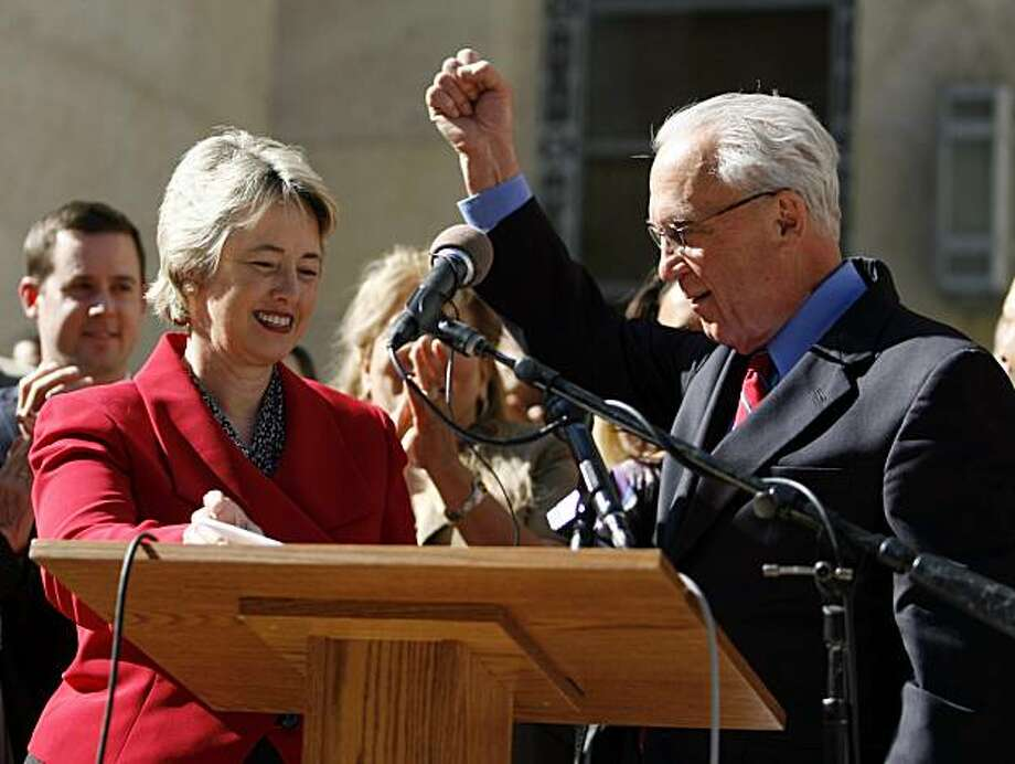 In this photo taken Tuesday, Nov. 10, 2009, Peter Brown raises a fist after he announced that he is endorsing Annise Parker for mayor, on the steps of city hall in Houston. If Parker wins the Dec. 12, 2009 runoff mayoral election, Houston would become what's believed to be the largest U.S. city ever to have an openly gay mayor _ and that has catapulted Parker's sexual orientation into the center of the race.  (AP Photo/Houston Chronicle, Karen Warren)  ** MANDATORY CREDIT ** Photo: Karen Warren, AP