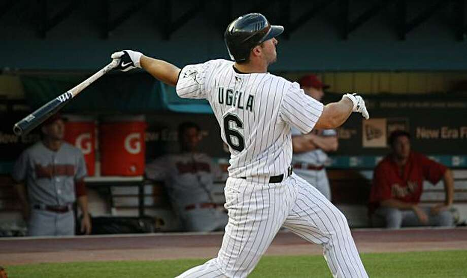 ** ADDS THAT GAME IS GAME 1 OF A DOUBLE HEADER ** Florida Marlins' Dan Uggla hits a three-run home run against the Arizona Diamondbacks in the sixth inning of Game 1 of a double header in Miami, Wednesday, May 20, 2009. (AP Photo/J Pat Carter) Photo: J Pat Carter, AP