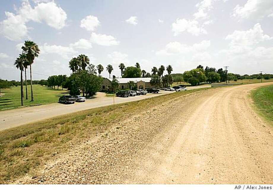 A dirt road, which follows the proposed path of a border fence is seen just south of the Fort Brown Memorial Golf Course in Brownsville, Texas on Wednesday, June 25, 2008. The levee which the dirt road rests on is the planned location for the border fence, leaving some concerned for the golf course's future. The Supreme Court said Monday it will not stand in the way as the U.S. extends its security fence hundreds of miles along the border with Mexico. (AP Photo/Alex Jones) Photo: Alex Jones, AP