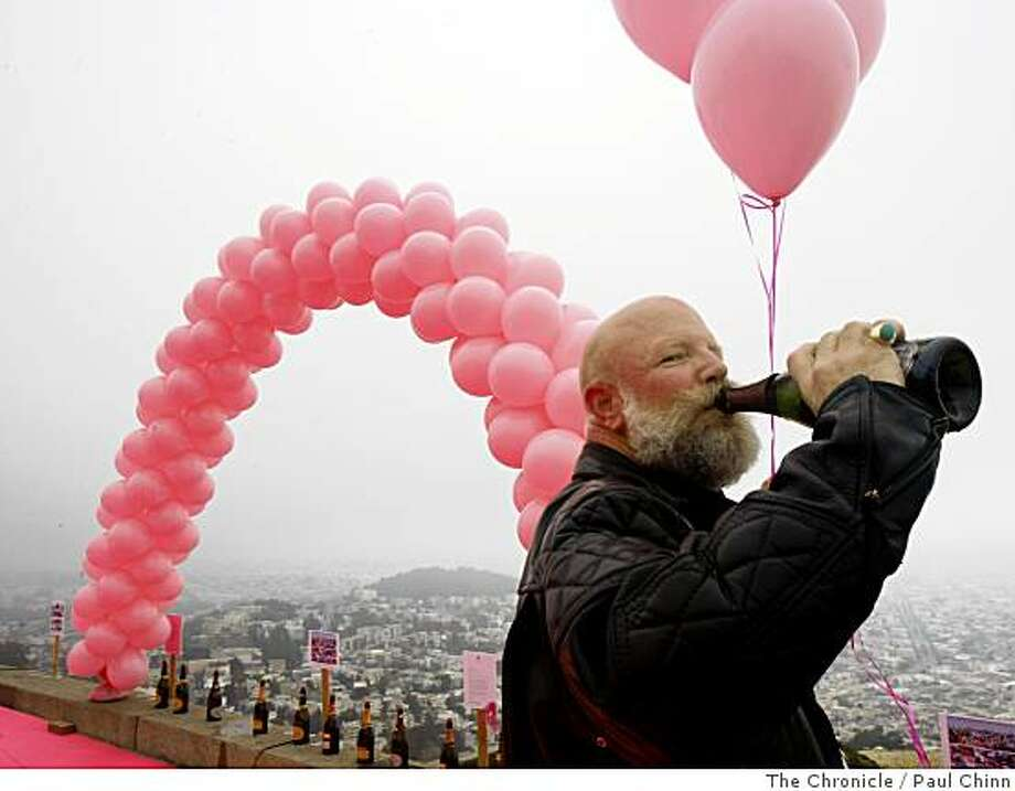 Norman Cuccio sips champagne after the pink triangle was installed on Twin Peaks in San Francisco, Calif., on Saturday, June 28, 2008.Photo by Paul Chinn / The Chronicle Photo: Paul Chinn, The Chronicle