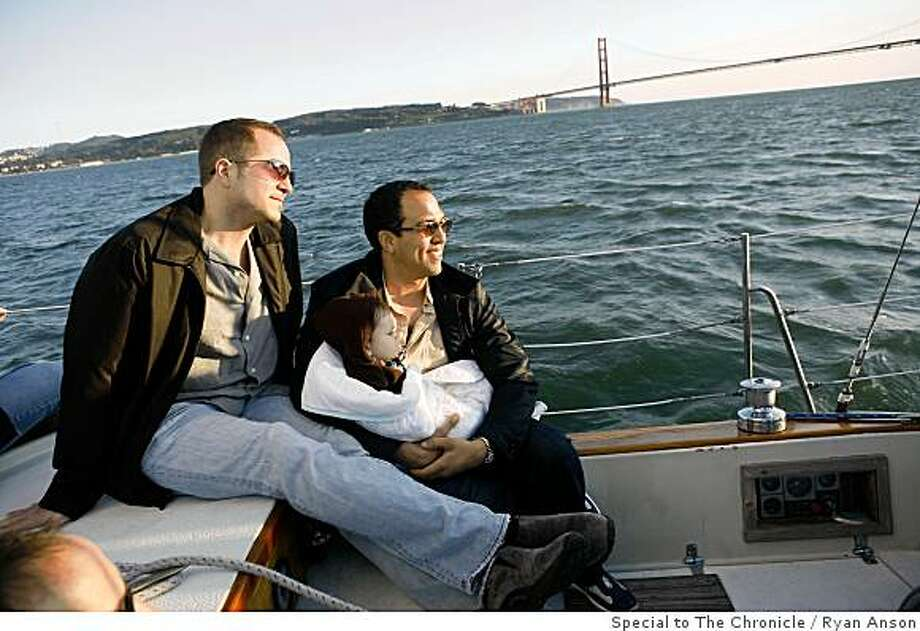 Eduardo Norfleet-Vilaro of Chicago, IL, right, and his partner Dave and son Max admire views of San Francisco Bay while taking a sunset cruise. Photo by Ryan Anson / Special to The Chronicle Photo: Ryan Anson, Special To The Chronicle