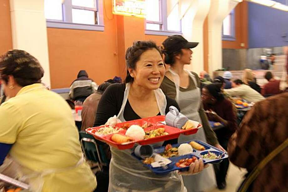 A volunteer serves food at Glide Memorial Church in 2008. Photo: Frank Jang
