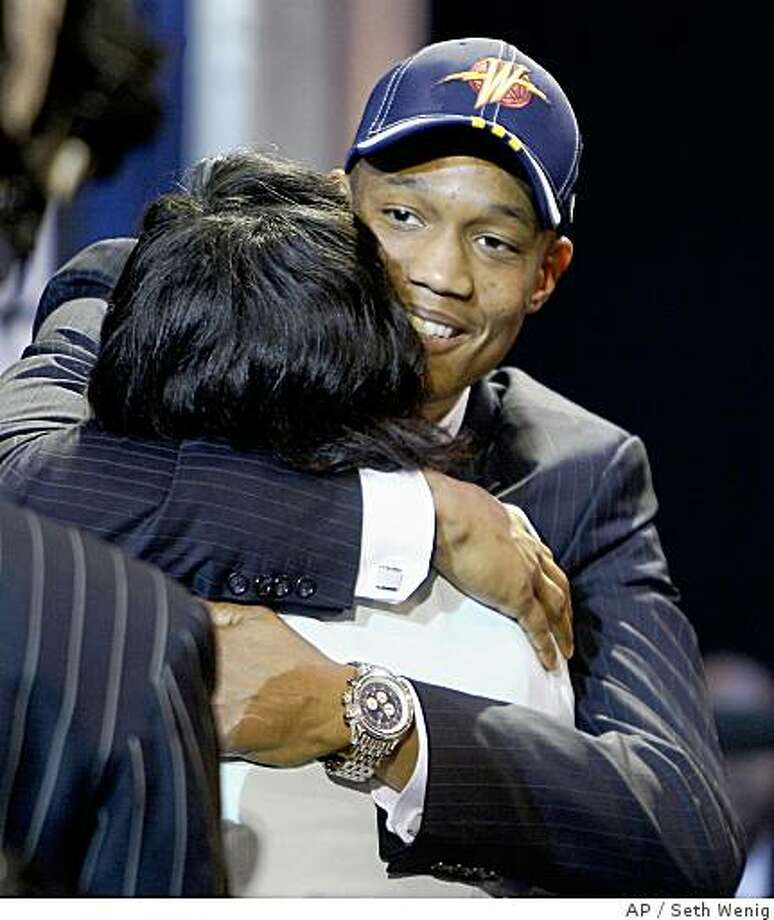 Anthony Randolph, right, is hugged by friends and relatives after being selected as the 14th overall pick by the Golden State Warriors during the first round of the NBA basketball draft, Thursday, June 26, 2008 in New York. (AP Photo/Seth Wenig) Photo: Seth Wenig, AP