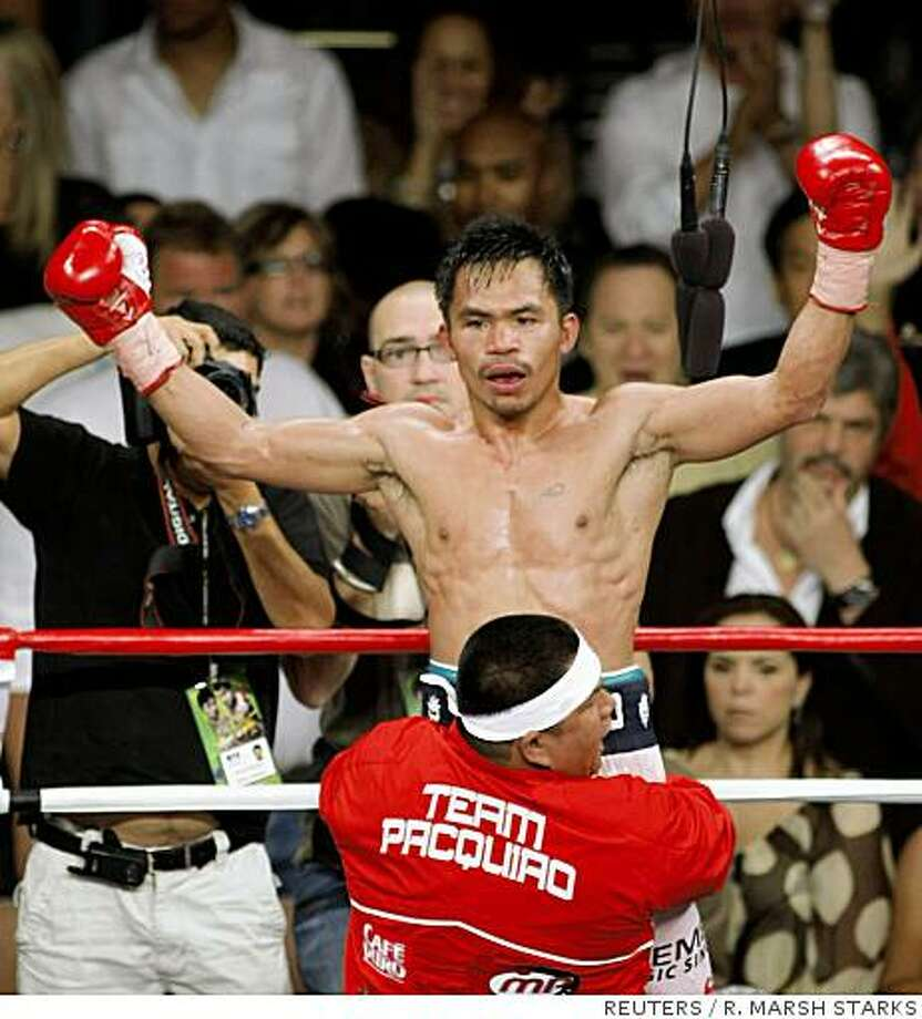 Manny Pacquiao of Philippines celebrates his knockout victory over David Diaz of the U.S. for the WBC lightweight title at the Mandalay Bay Events Center in Las Vegas, Nevada on June 28, 2008. REUTERS/R. Marsh Starks (UNITED STATES) Photo: R. MARSH STARKS, REUTERS