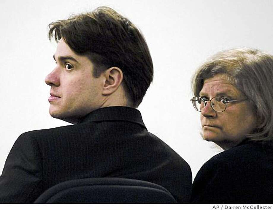 Neil Entwistle and defense attorney Stephanie Page, right, watch as family members of Entwistle's late wife walk past after they read impact statements during Entwistle's sentencing at Middlesex Superior Court in Woburn, Mass., Thursday, June 26, 2008. Entwistle, born in England, was convicted Wednesday of first-degree murder in the death of his wife, Rachel, and infant daughter, Lillian, in their Hopkinton, Mass., home in January 2006. (AP Photo/Darren McCollester, Pool) Photo: Darren McCollester, AP