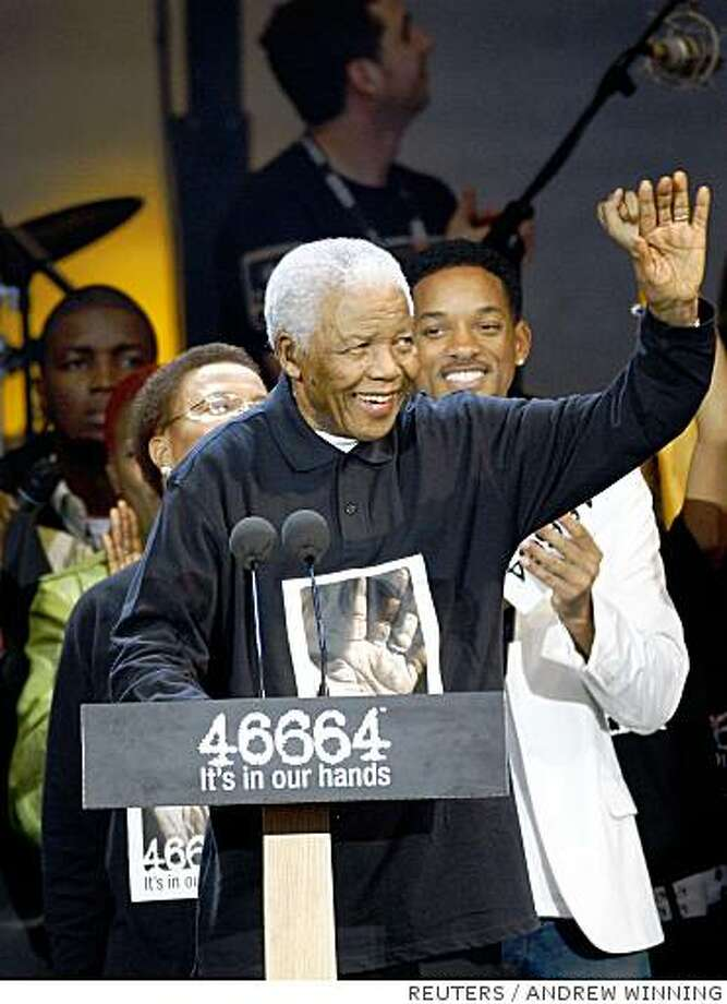 "Former South African President Nelson Mandela waves during the 46664 concert held in his honour in Hyde Park, London June 27, 2008. The event was organized to raise funds for Nelson Mandela's HIV/AIDS ""46664"" campaign, named after his prison number. Exactly 46,664 people were expected to attend the event, which also celebrates the former South African president's 90th birthday on July 18.     REUTERS/Andrew Winning (BRITAIN) Photo: ANDREW WINNING, REUTERS"