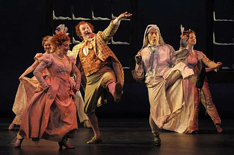 Scrooge (James Carpenter) canÕt help but dance as he relives a past Christmas celebration with the jovial Mr. Fezziwig (Jarion Monroe) and Mrs. Fezziwig (Sharon Lockwood). Photo: Kevin Berne
