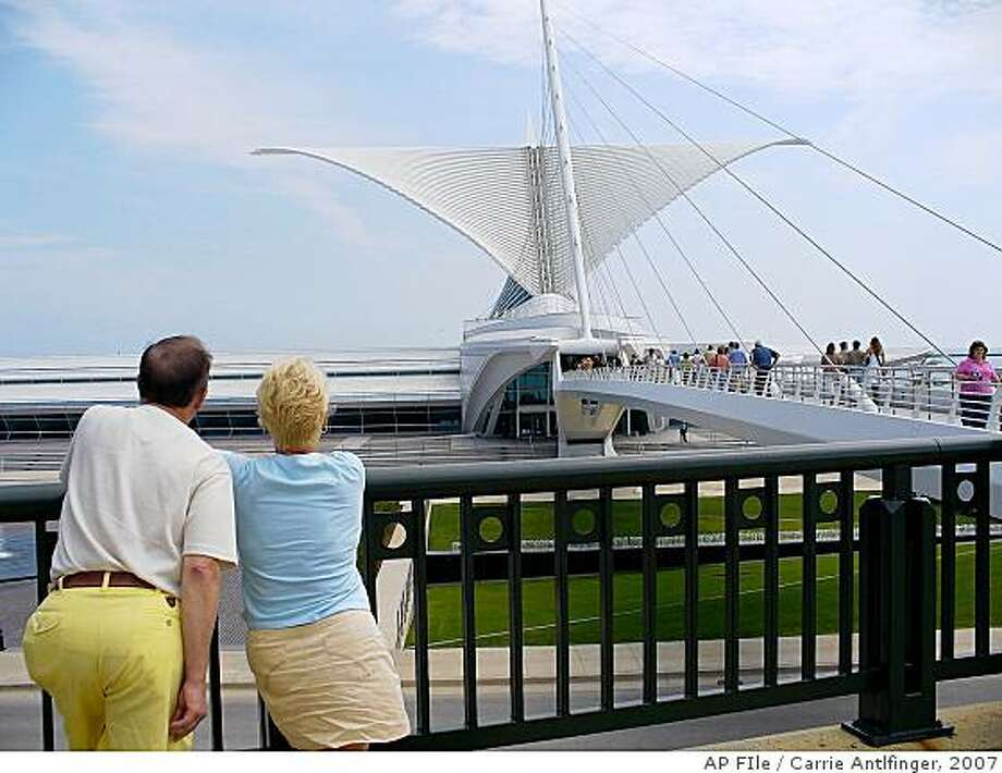**FILE**This Aug. 8, 2007 file photo show the Milwaukee Art Museum   in Milwaukee. 2008 marks seven years after the grand white addition designed by Calatrava opened on Milwaukee's lakefront _ his first completed project in the United States. It has helped pull the museum out of $30 million in debt, increased attendance and attracted acclaimed exhibits. (AP Photo/Carrie Antlfinger,File) Photo: Carrie Antlfinger, 2007, AP FIle