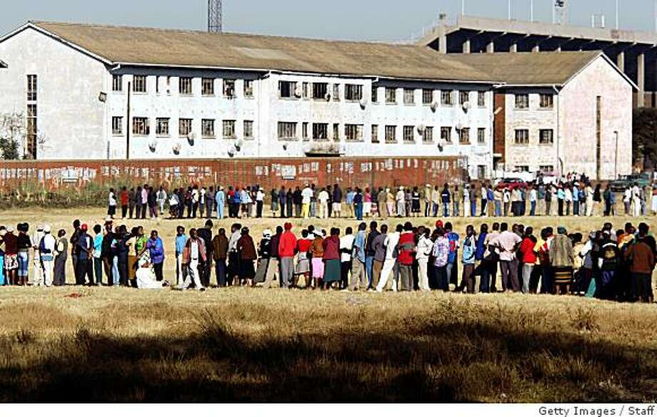 HARARE, ZIMBABWE - JUNE 27:  Voters line up to cast their ballots on June 27, 2008 in Harare, Zimbabwe. The runoff presidential election, which is being boycotted by oppostion leader Morgan Tsvangirai only has one candidate running which is President Robert Mugabe. The international community had appealed to Mugabe to postpone the vote but was ignored.  (Photo by Getty Images) Photo: Staff, Getty Images