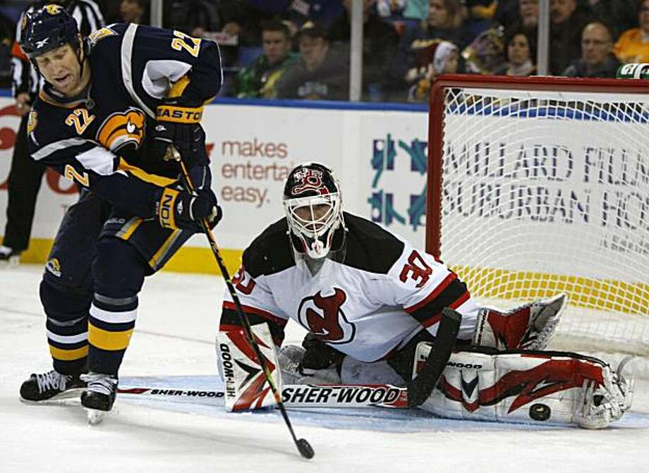Buffalo Sabres' Adam Mair shoots on New Jersey Devils goalie Martin Brodeur during the third period of the NHL hockey game in Buffalo, N.Y., Monday, Dec. 7, 2009. The Devils won 3-0. (AP Photo/ David Duprey) Photo: David Duprey, AP
