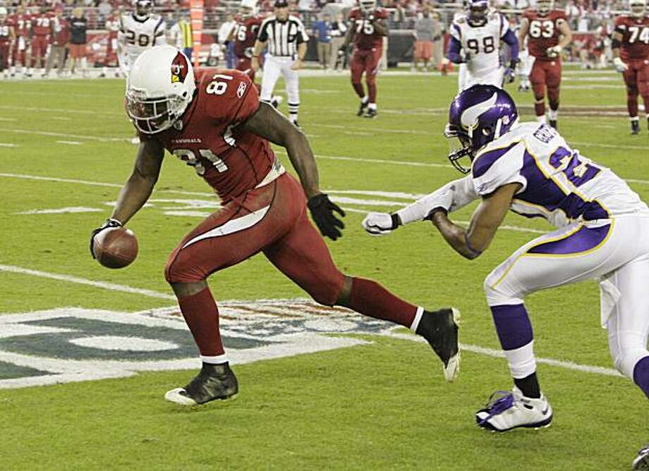 Arizona Cardinals' Anquan Boldin (81) gets past Minnesota Vikings' Cedric Griffin and heads for a touchdown in the second quarter during an NFL football game Sunday, Dec. 6, 2009, in Glendale, Ariz. (AP Photo/Ross D. Franklin) Photo: Ross Franklin, AP