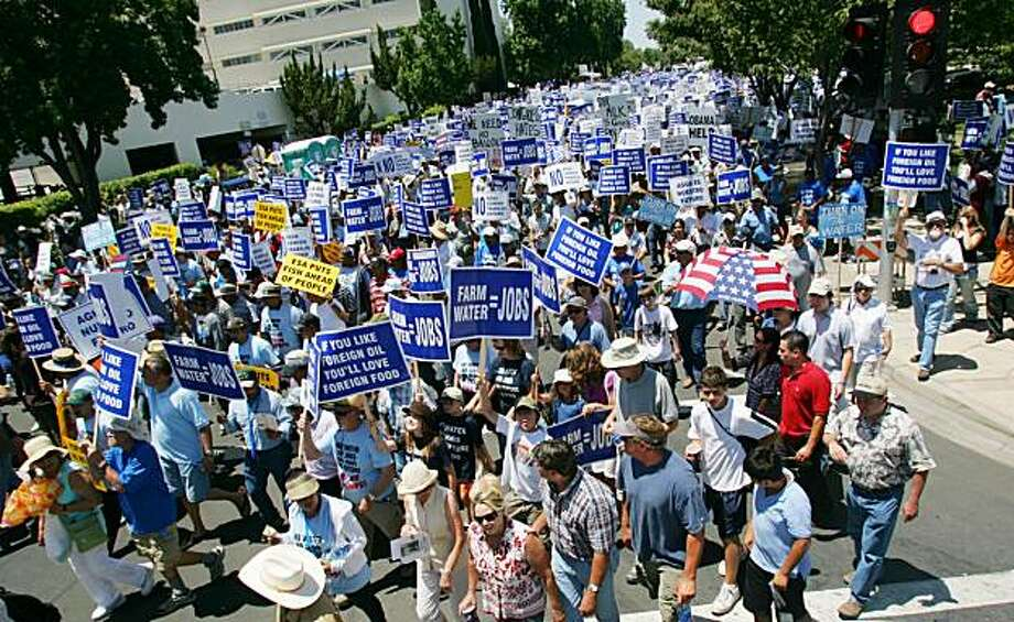 Thousands of farmers, farm workers and their supporters march to protest water shortages Wednesday,  July 1, 2009 in Fresno, Calif. Protesters were hopeful a show of force would prompt an easing of federal regulations that have cut water supplies to the nation's most prolific growing region.(AP Photo/Gary Kazanjian) Photo: Gary Kazanjian, AP