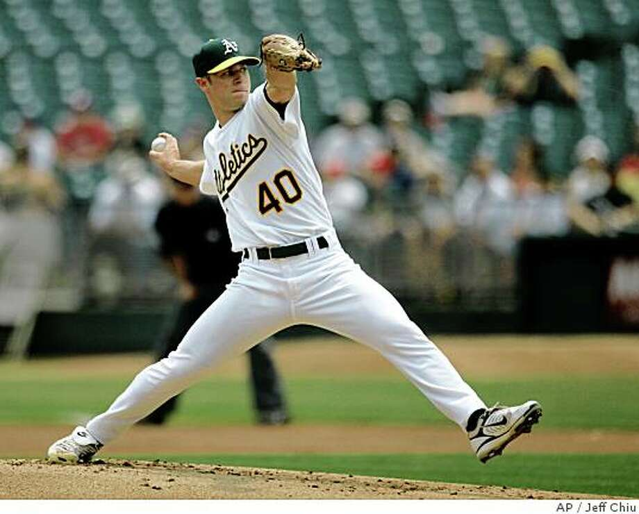 Oakland Athletics' Rich Harden pitches to the Philadelphia Phillies in the first inning of a baseball game Thursday, June 26, 2008, in Oakland, Calif. Harden struck out 11 batters in 8 innings and improved his record to 5-0. Photo: Jeff Chiu, AP