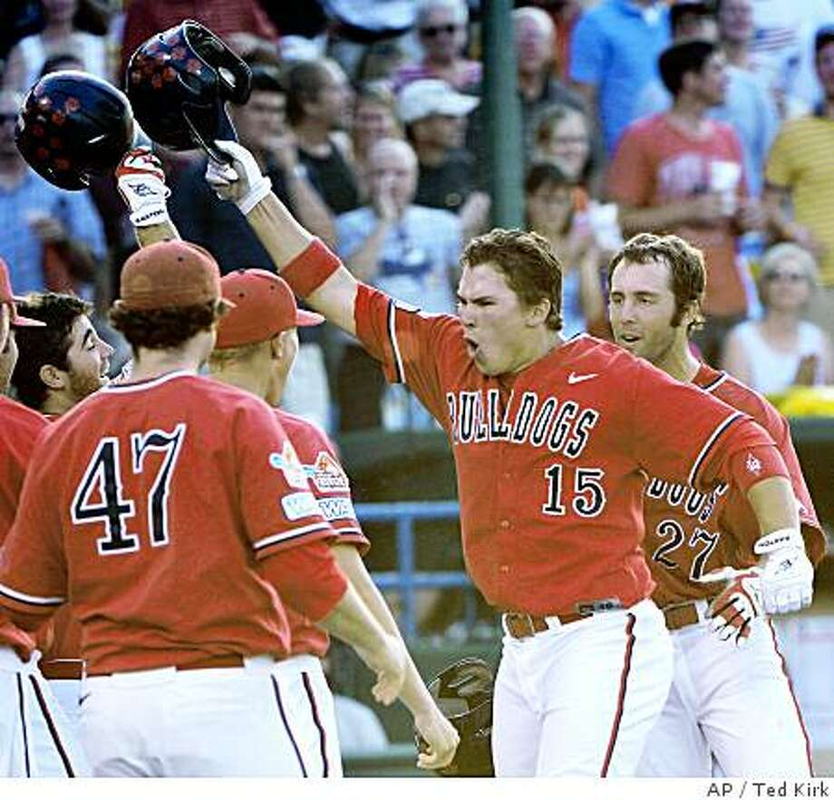 Fresno State's Steve Detwiler (15) celebrates his three-run home run against Georgia in the sixth inning of Game 3 of the best-of-three NCAA College World Series championship baseball series, in Omaha, Neb., Wednesday, June 25, 2008. (AP Photo/Ted Kirk) Photo: Ted Kirk, AP