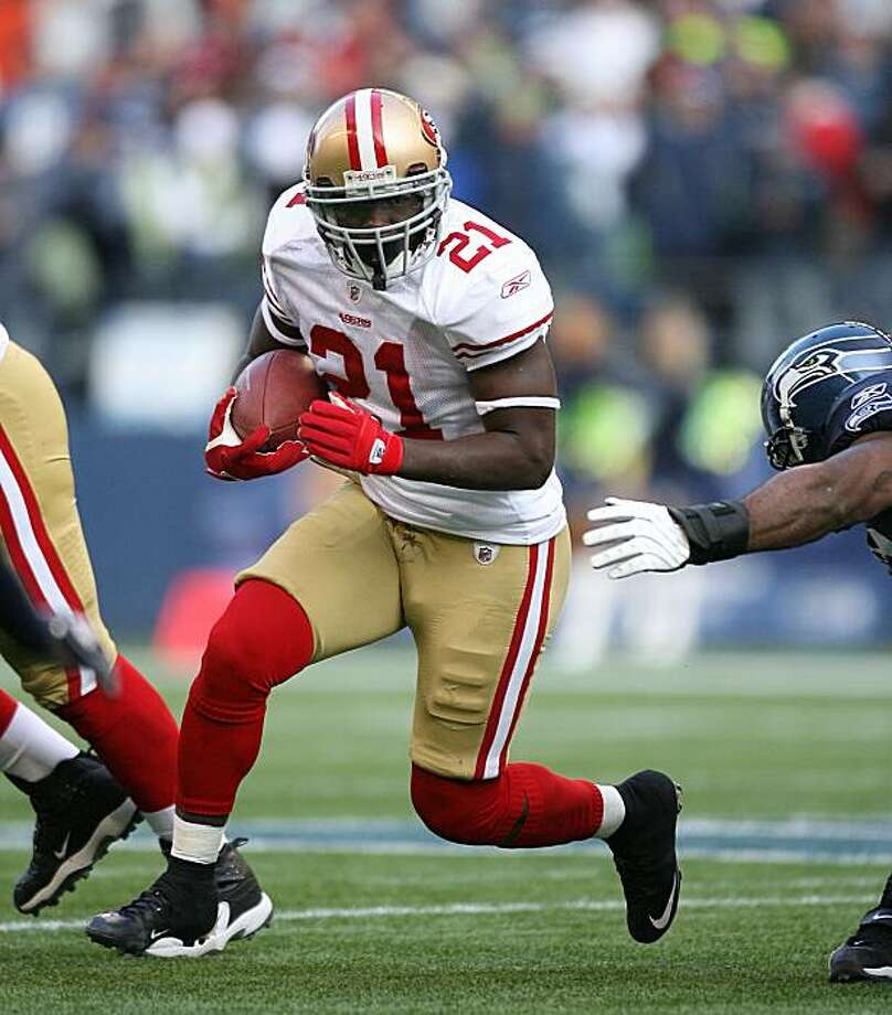 SEATTLE - DECEMBER 06:  Runningback Frank Gore #21 of the San Francisco 49ers rushes against the Seattle Seahawks on December 6, 2009 at Qwest Field in Seattle, Washington. The Seahawks defeated the 49ers 20-17. (Photo by Otto Greule Jr/Getty Images) Photo: Otto Greule Jr, Getty Images