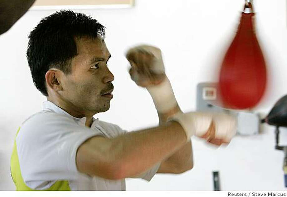 Manny Pacquiao of Philippines hits a speedbag at a gym in Las Vegas, Nevada June 25, 2008. Pacquiao will challenge WBC lightweight champion David Diaz of the U.S. for the WBC lightweight title at the Mandalay Bay Events Center on June 28. Photo: Steve Marcus, Reuters