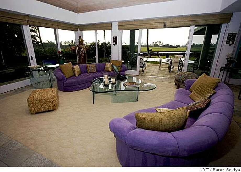 "(NYT27) KONA, Hawaii -- June 19, 2008 -- HAWAII-PEACE-HOUSE-2 --  The living room of Rinaldo and Lalla Brutoco's home on the Big Island of Hawaii, May 2008. Their home called ""The House of Peace,"" was once owned by the fantasy writer Terry Brooks. It has ""Hobbit Gardens."" (Baron Sekiya/The New York Times) Photo: Baron Sekiya, NYT"