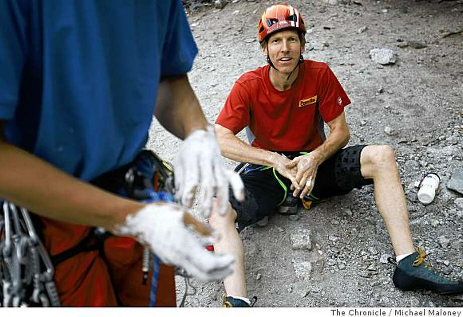 Yuji Hirayama, left, of Japan chalks up his hands as he and his climbing partner Hans Florine, of Lafayette, Calif., right, prepare to climb up El Capitan.  They attempted a new record of climbing the Nose route of El Capitan in Yosemite National Park on June 26, 2008. Their time was 3 hours and 28 minutes. The time they needed to beat was 2 hours and 45 minutes.Photo by Michael Maloney / The Chronicle Photo: Michael Maloney, The Chronicle