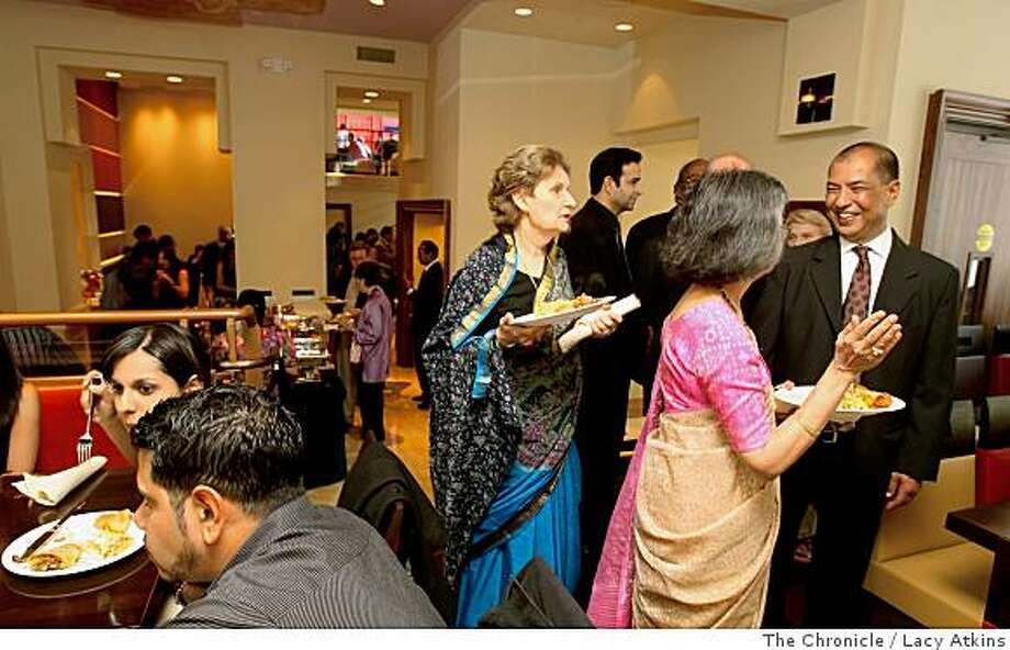 People gather for a private opening to introduce the Amber India restaurant in downtown San Francisco. Photo: Lacy Atkins, The Chronicle