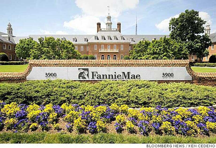 Flowers grow in front the headquarters of Fannie Mae in Washington, D.C., U.S., on Monday, May 5, 2008. Fannie Mae reported a $2.19 billion loss as record home foreclosure rates and falling real estate prices drove the largest U.S. mortgage-finance company into its third straight period of losses. The company plans to raise $6 billion in capital and cut its dividend.  Photographer: Ken Cedeno/Bloomberg News Photo: KEN CEDENO, BLOOMBERG NEWS