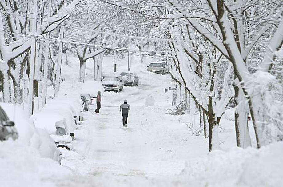 MADISON, WI - DECEMBER 9: A runner makes her way down a snowy street doing errends December 9, 2009, in Madison, Wisconsin. Madison and the surrounding area has been hit with about 15-18 inches of snow with more snow to come. (Photo by Andy Manis/Getty Images) Photo: Andy Manis, Getty Images