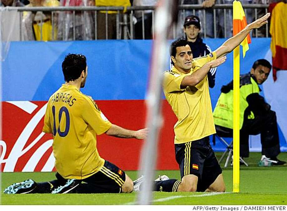 Spanish forward Daniel Guiza (R) gestures in celebration after scoring as Spanish midfielder Cesc Fabregas joins him during the Euro 2008 championships semi-final football match Russia vs. Spain on June 26, 2008 at Ernst-Happel stadium in Vienna, Austria. AFP PHOTO / DAMIEN MEYER -- MOBILE SERVICES OUT -- (Photo credit should read DAMIEN MEYER/AFP/Getty Images) Photo: DAMIEN MEYER, AFP/Getty Images