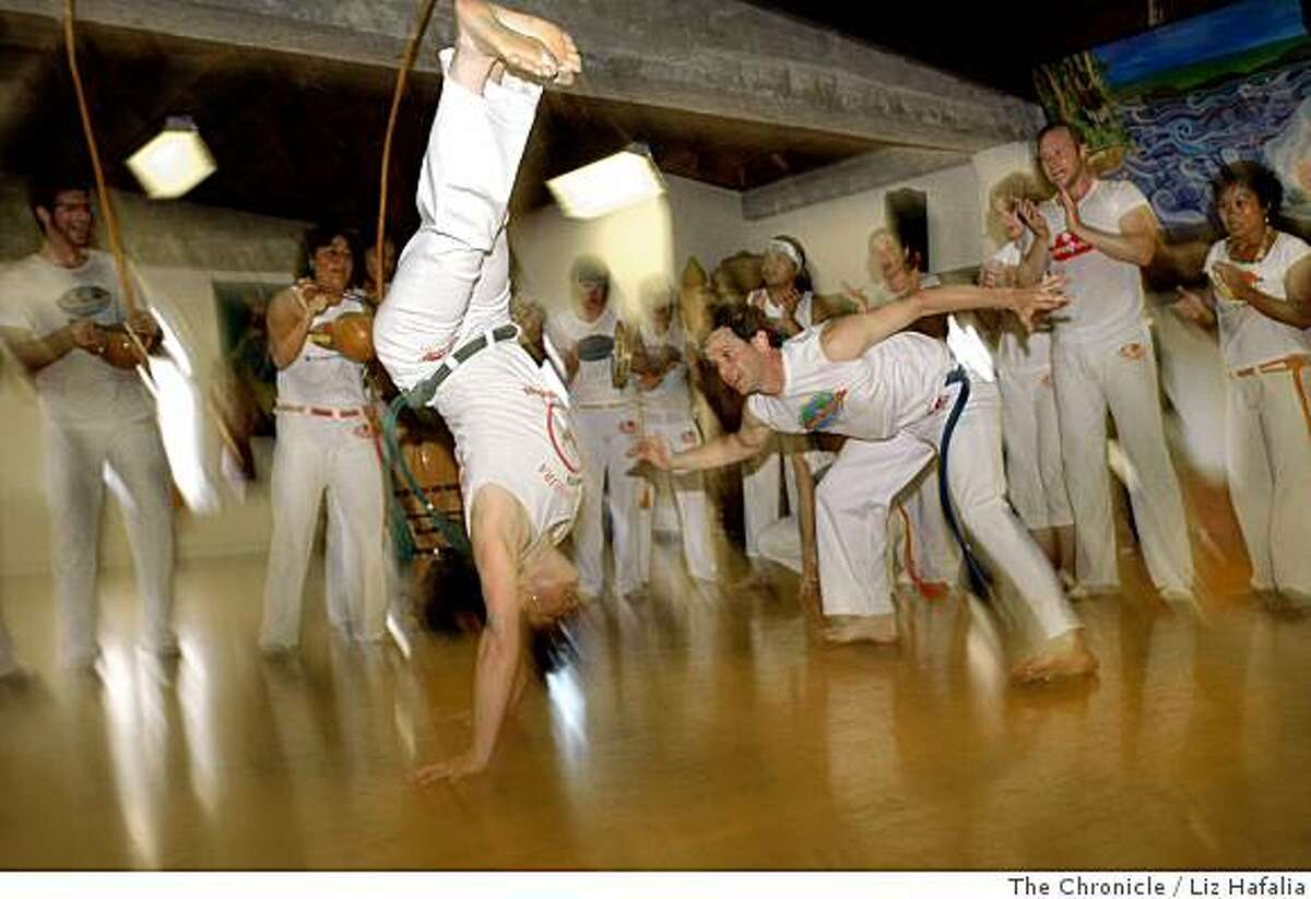 Sara Breselor (left) and Isaac McGowan (right) practicing capoeira, an Afro-Brazilian martial art in San Francisco, Calif., on Thursday, June19, 2008. Photo by Liz Hafalia/The Chronicle