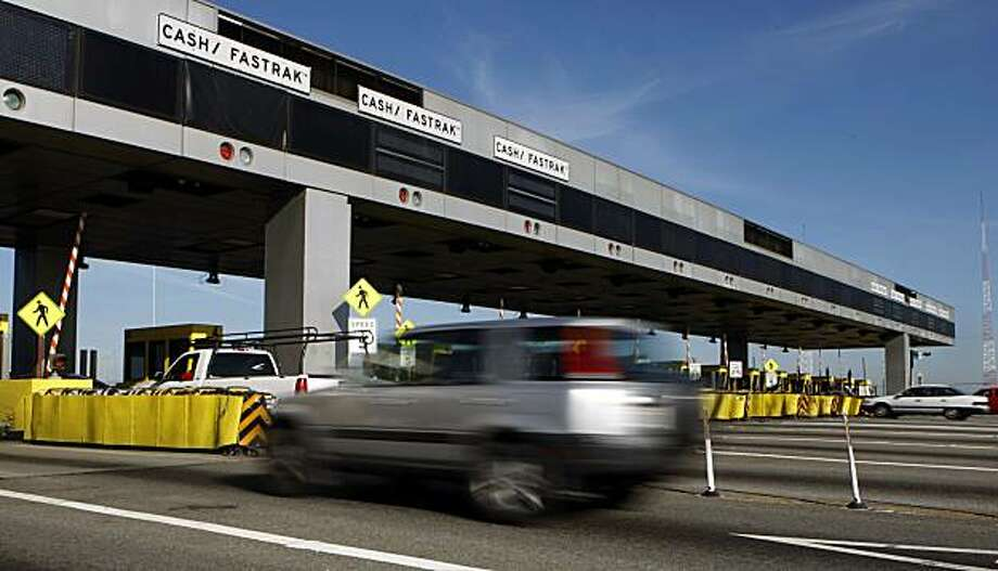 Morning rush hour traffic breezes through the Bay Bridge toll plaza in Oakland, Calif., on Friday, April 17, 2009. With more people out of work, revenues generated from tolls at state-owned bridges are decreasing forcing transit officials to consider raising the tolls. Photo: Paul Chinn, The Chronicle
