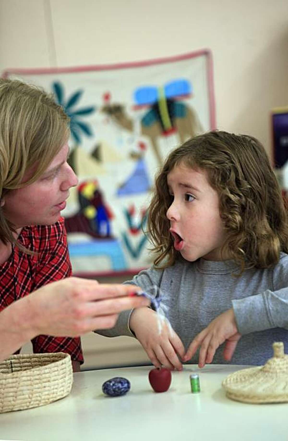 Ulisess Piva, 4, (right) works with Karla Norgaard (left), Montessori program Room 1 teacher, while they work on naming at Cobb Elementary School in San Francisco, Calif. on Tuesday November 17, 2009.
