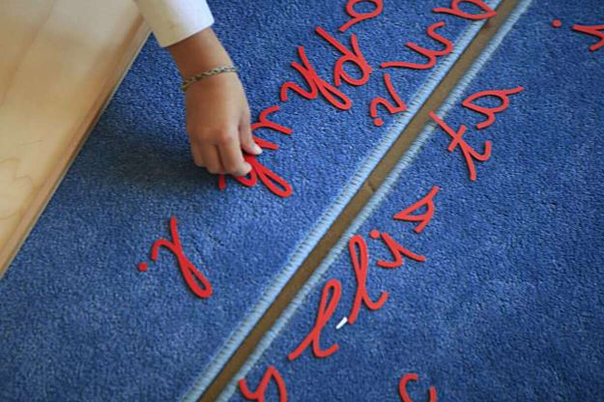 Narayan Rueppel, 5, places letters together while working with a moveable alphabet at Cobb Elementary School in San Francisco, Calif. on Tuesday November 17, 2009.