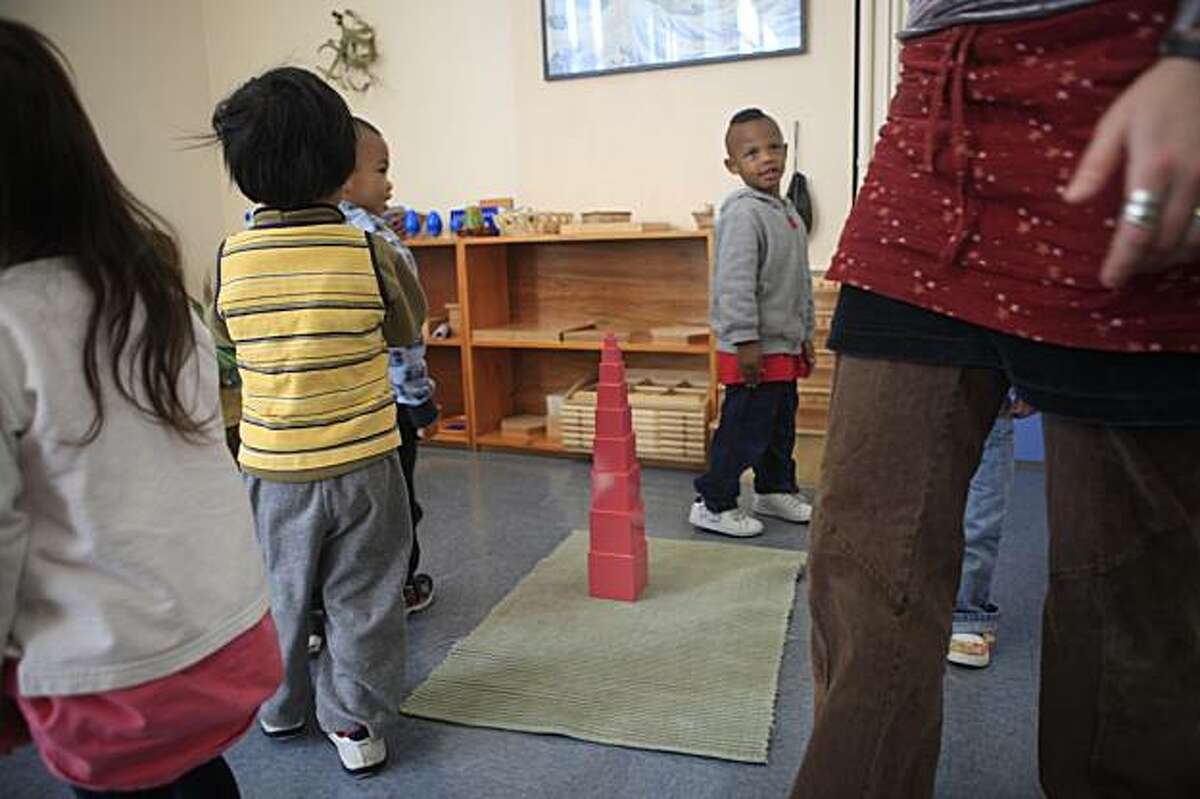 The children in the Montessori program in room 4 follow their teacher Nadine Rozenoer (far right) Montessori program room 4 teacher in a cirlce around a pink tower at Cobb Elementary School in San Francisco, Calif. on Tuesday November 17, 2009.