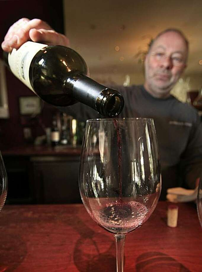 John Wiltshire pours a Merlot at The Pey-Marin tasting room Olema Inn, in Olema Calif., on October 17, 2009. Photo: Frederic Larson, The Chronicle