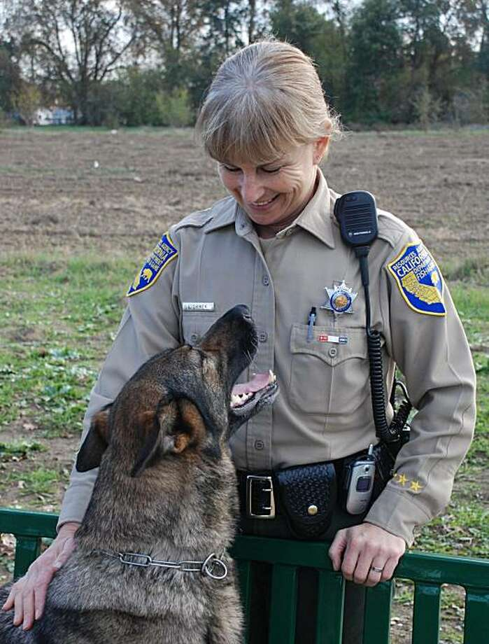 Ellen, the DFG's K-9 game warden, and her handler, Lt. Lynette Shimek Photo: Courtesy DFG