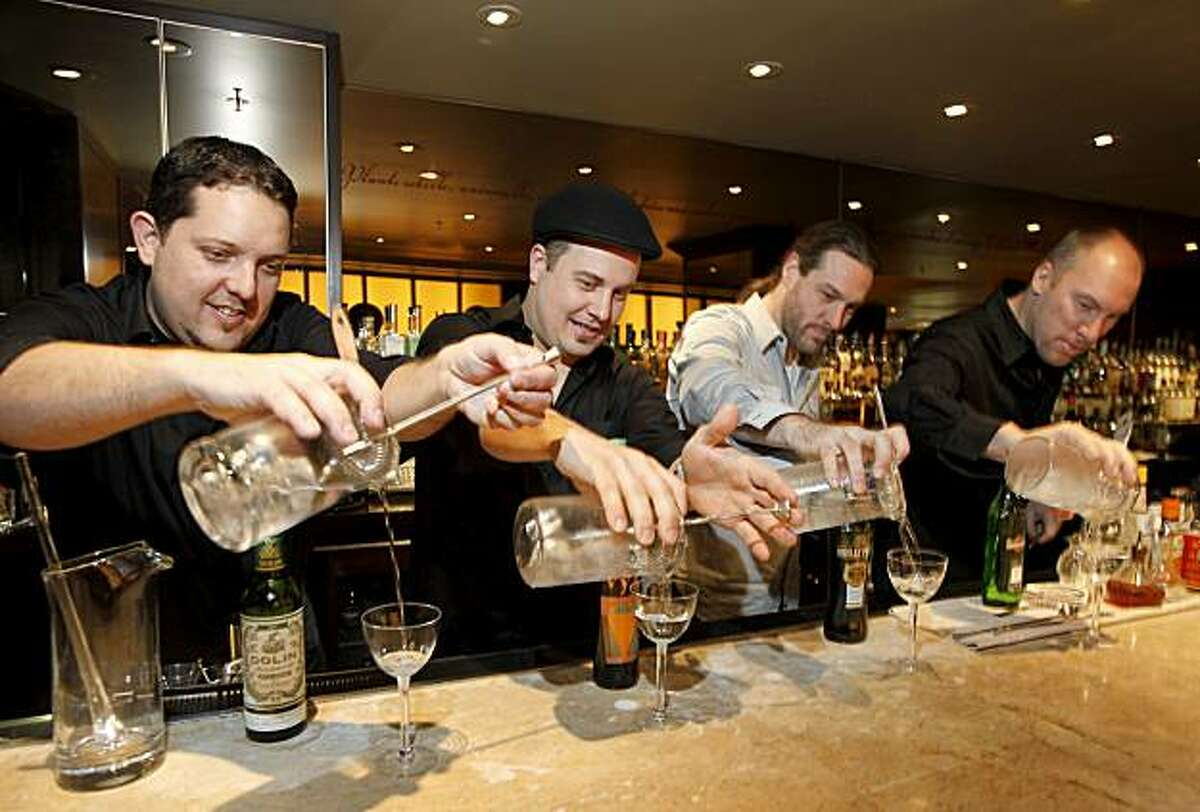 Bartenders (left to right) Jacques Bezuidenhout, Marco Dionysos, Ryan Fitzgerald and Eric Johnson mix their drinks. An experimental martini mixing session as held Sunday November 22, 2009 at the Fifth Floor in the Hotel Palomar in San Francisco, CA.