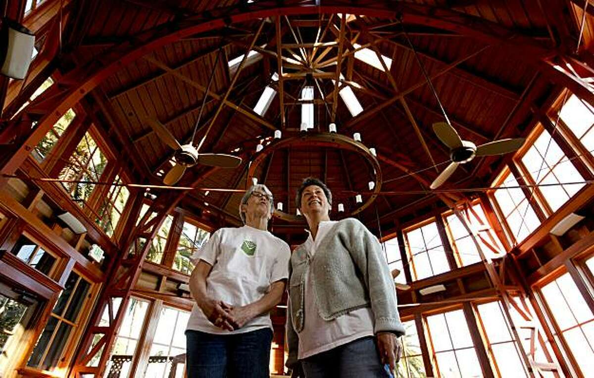 """Sally Ross, (left) and Andrea O'Leary, members of the """"Friends of Sunnyside Conservatory, who also live close by, under the restored Conservatory after a major restoration project of the 1898 landmark in San Francisco, Ca."""