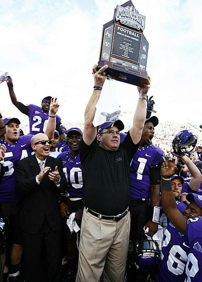 TCU head coach Gary Patterson holds the Mountain West championship trophy while celebrating a 51-10 win over New Mexico after an NCAA college football game Saturday, Nov. 28, 2009, in Fort Worth, Texas.  TCU finished the regular season with a perfect 12-0 record. (AP Photo/Tom Pennington) Photo: Tom Pennington, AP