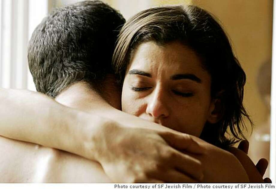 "Liron Levo as Eyal and Lubna Azabal as Rana, share an intimate moment in ""Strangers."" Photo courtesy of SF Jewish Film FestivalLiron Levo as Eyal and Lubna Azabal as Rana, share an intimate moment in ""Strangers."" Photo courtesy of SF Jewish Film Festival Photo: Photo Courtesy Of SF Jewish Film"