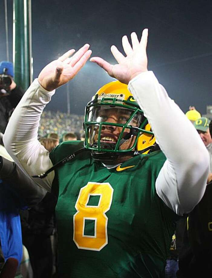 EUGENE,OR - DECEMBER 03: Quarterback Jeremiah Masoli #8 of the Oregon Ducks celebrates after defeating the Oregon State Beavers 33-37 at Autzen Stadium on December 3, 2009 in Eugene, Oregon. (Photo by Tom Hauck/Getty Images) Photo: Tom Hauck, Getty Images