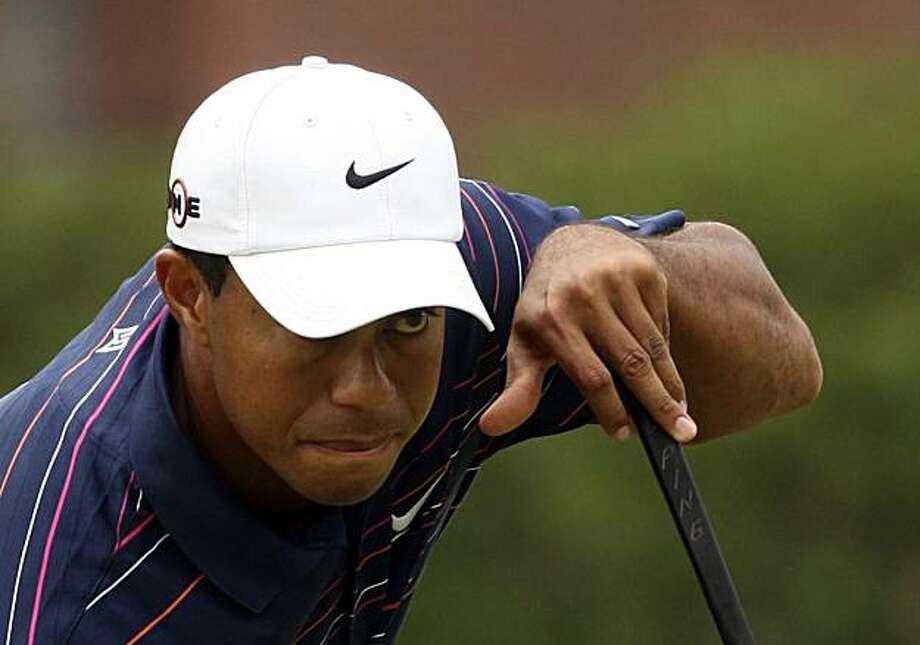 Tiger Woods of the USA lines up a shot on the 5th green  in  Melbourne, Australia, Thursday, Nov. 12, 2009 during the first round  of the Australian Masters golf tournament . Woods finished the round 6 under the card.(AP Photo/Rob Griffith)(AP Photo/Rob Griffith) Photo: Rob Griffith, AP