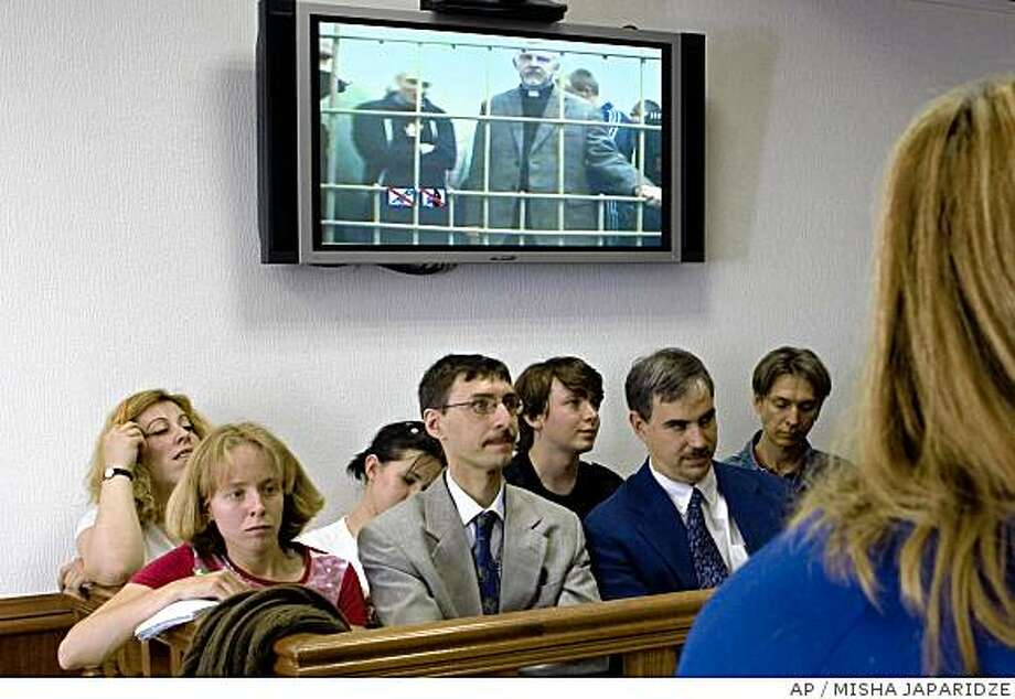 U.S. pastor Phillip Miles, right, listens to a sentence in a Moscow court, Monday, June 23, 2008 as he is seen via videolink. A Russian court on Monday cut the three-year prison sentence of a U.S. pastor jailed for smuggling hunting ammunition into the country, which could see him freed as early as Tuesday. The Moscow City Court reduced Phillip Miles sentence to 10 months and suspended the remaining six months.  (AP Photo/Misha Japaridze) Photo: MISHA JAPARIDZE, AP