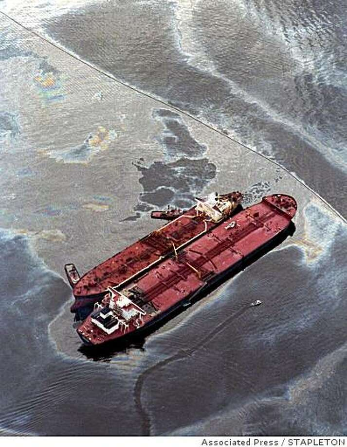 The smaller Exxon Baton Rouge attempts to off-load crude oil March 26,1989, from the Exxon Valdez, aground in Alaska's Prince William Sound. The tanker spilled 11 million gallons of crude in America's worst oil spill. (AP Photo/Stapleton) Photo: STAPLETON, Associated Press
